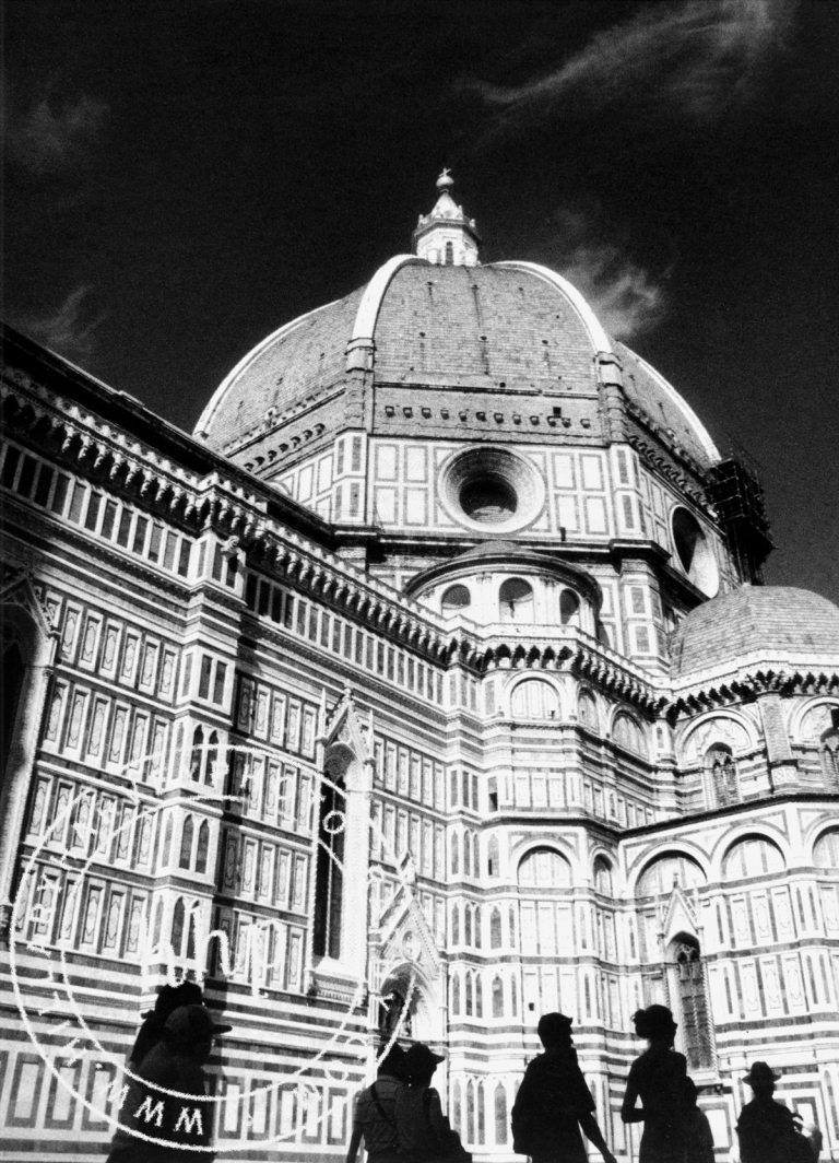 The Duomo, Florence, Italy, with tourists in silhouette